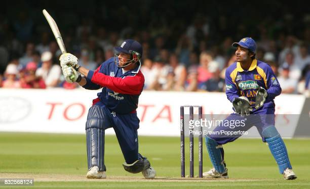 Marcus Trescothick of England bats during his innings of 67 runs watched by Sri Lanka wicketkeeper Kumar Sangakkara in the 1st NatWest Series One Day...