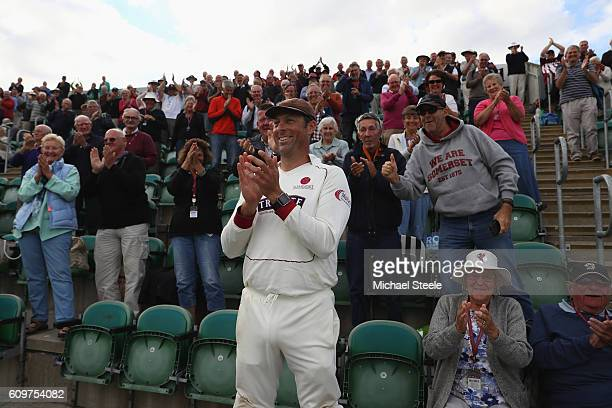 Marcus Trescothick of Somerset leads the applause from the 'Marcus Trescothick Stand' during a lap of honour concluding his sides 325 run victory...