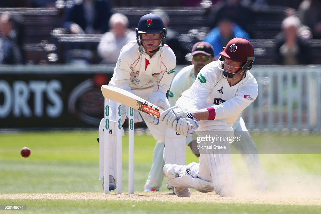 <a gi-track='captionPersonalityLinkClicked' href=/galleries/search?phrase=Marcus+Trescothick&family=editorial&specificpeople=171643 ng-click='$event.stopPropagation()'>Marcus Trescothick</a> of Somerset sweeps as wicketkeeper Alex Davies looks on during day four of the Specsavers County Championship Division One match between Somerset and Lancashire at The Cooper Associates County Ground on May 4, 2016 in Somerset, United Kingdom.