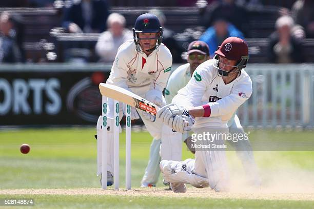 Marcus Trescothick of Somerset sweeps as wicketkeeper Alex Davies looks on during day four of the Specsavers County Championship Division One match...