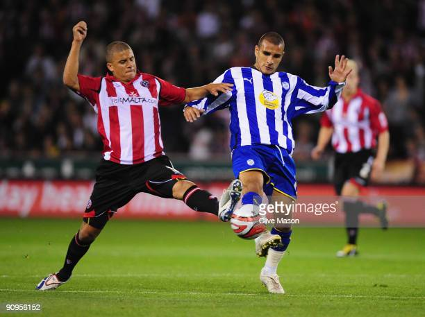 Marcus Tudgay of Sheffield Wednesday is challenged by Kyle Walker of Sheffield United during the CocaCola Championship match between Sheffield United...