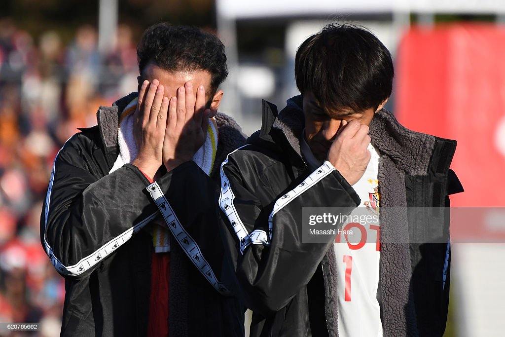 Marcus Tulio Tanaka (L) and Seigo Narazaki of Nagoya Grampus look on after their relegation to the second division after the J.League match between Nagoya Grampus and Shonan Bellmare at Paroma Mizuho Stadium on November 3, 2016 in Nagoya, Aichi, Japan.