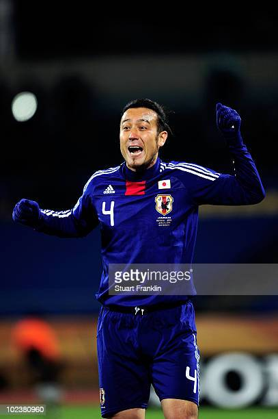 Marcus Tulio Tanaka of Japan gestures to team mates during the 2010 FIFA World Cup South Africa Group E match between Denmark and Japan at the Royal...