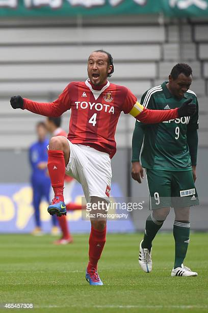 Marcus Tulio Tanaka of Nagoya Grampus advices his team mate Seigo Narazaki of Nagoya Grampus how to stop coceding a goal during the J League match...
