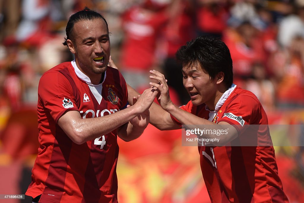 <a gi-track='captionPersonalityLinkClicked' href=/galleries/search?phrase=Marcus+Tulio+Tanaka&family=editorial&specificpeople=1541600 ng-click='$event.stopPropagation()'>Marcus Tulio Tanaka</a> of Nagoya Grampus celebrates 3rd goal with <a gi-track='captionPersonalityLinkClicked' href=/galleries/search?phrase=Kensuke+Nagai&family=editorial&specificpeople=6548859 ng-click='$event.stopPropagation()'>Kensuke Nagai</a> of Nagoya Grampus during the J.League match between Nagoya Grampus and Shonan Bellmare at Mizuho Stadium on May 2, 2015 in Nagoya, Aichi, Japan.
