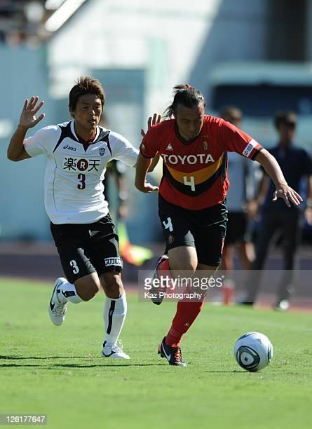 Marcus Tulio Tanaka of Nagoya Grampus dribbles while Takahito Soma chasing the ball during the JLeague match between Nagoya Grampus and Vissel Kobe...