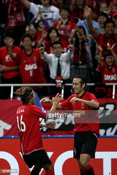 Marcus Tulio Tanaka of Urawa Red Diamonds celebrates his goal against Al Qadsia with his teammate Takahito Soma during the Asia Champions League...