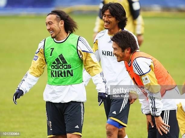 Marcus Tulio Tanaka Yuji Nakazawa and Daiki Iwamasa share a laugh during a Japan training session at SaasFee Stadium on May 28 2010 in SaasFee...