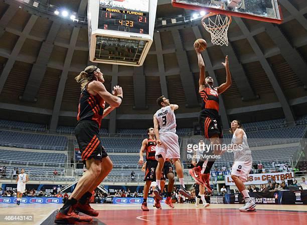 Marcus Vinicius Souza of Flamengo drives against Alejandro Konsztadt of Penarol Mar del Plata during Final Four Liga de Las Americas FIBA 2015 Third...