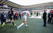 Marcus Watson of England and Ben Lam of New Zealand run out onto the pitch for their Pool A match between New Zealand and England during the Marriott...
