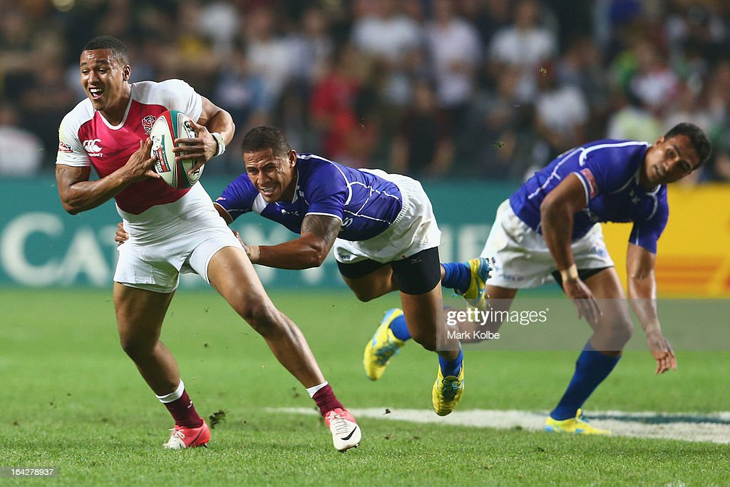 Marcus Watson of England breaks the tackle during the match between England and Samoa day one of the 2013 Hong Kong Sevens at Hong Kong Stadium on...