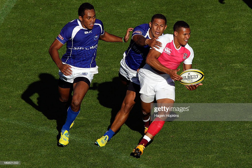 Marcus Watson of England is tackled by Alatasi Tupou of Samoa in the semifinal cup match between England and Samoa during the 2013 Wellington Sevens at Westpac Stadium on February 2, 2013 in Wellington, New Zealand.