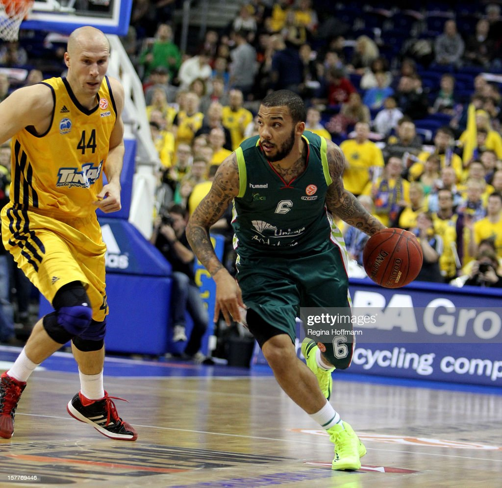 Marcus Williams, #6 of Unicaja Malaga competes with <a gi-track='captionPersonalityLinkClicked' href=/galleries/search?phrase=Zach+Morley&family=editorial&specificpeople=213554 ng-click='$event.stopPropagation()'>Zach Morley</a>, #44 of Alba Berlin during the 2012-2013 Turkish Airlines Euroleague Regular Season Game Day 9 between Alba Berlin v Unicaja Malaga at O2 Arena on December 6, 2012 in Berlin, Germany.