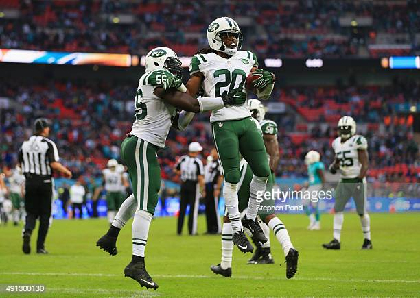 Marcus Williams of the New York Jets celebrates his interception with Demario Davis of the New York Jets during the game against Miami Dolphins at...