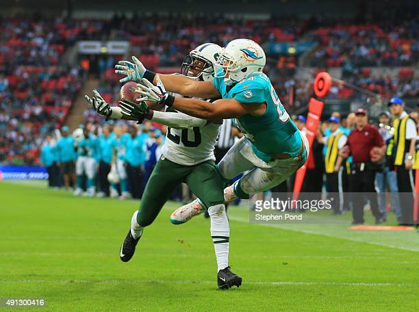 Marcus Williams of the New York Jets intercepts a pass intended for Jordan Cameron of the Miami Dolphins during the game at Wembley Stadium on...