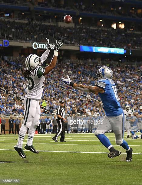 Marcus Williams of the New York Jets intercepts the pass from quarterback Kellen Moore of the Detroit Lions to end the second quarter of the...