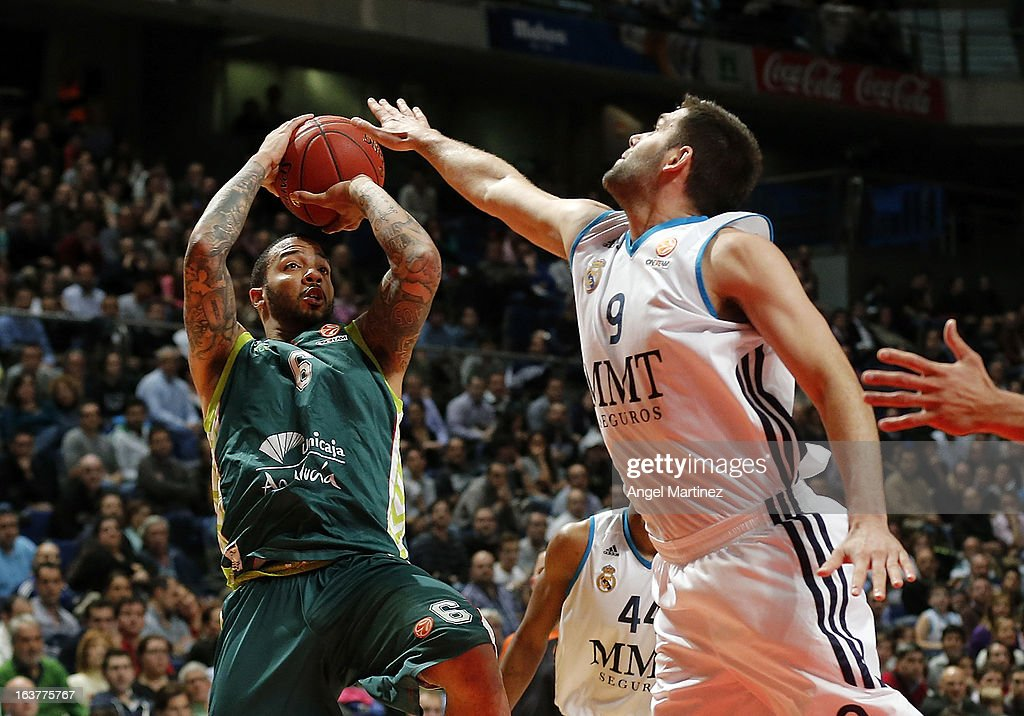 Marcus Williams #6 of Unicaja Malaga aims to shoot against <a gi-track='captionPersonalityLinkClicked' href=/galleries/search?phrase=Felipe+Reyes&family=editorial&specificpeople=732755 ng-click='$event.stopPropagation()'>Felipe Reyes</a> #9 of Real Madrid during the Turkish Airlines Euroleague Top 16 game at Palacio de los Deportes on March 15, 2013 in Madrid, Spain.