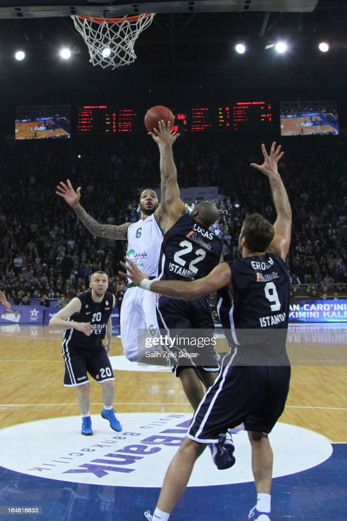 Marcus Williams #6 of Unicaja Malaga competes with Jamon Lucas #22 and <a gi-track='captionPersonalityLinkClicked' href=/galleries/search?phrase=Semih+Erden&family=editorial&specificpeople=2550292 ng-click='$event.stopPropagation()'>Semih Erden</a> #9 of Anadolu Efes during the 2012-2013 Turkish Airlines Euroleague Top 16 Date 13 between Anadolu EFES Istanbul v Unicaja Malaga at Abdi Ipekci Sports Arena on March 28, 2013 in Istanbul, Turkey.