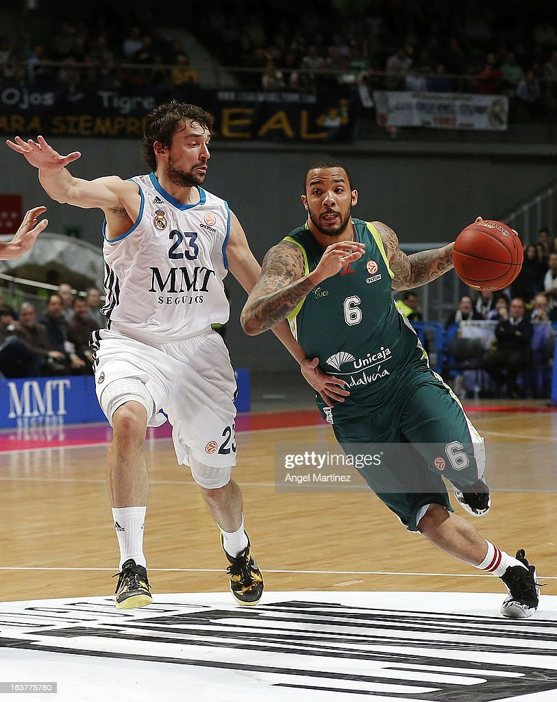 Marcus Williams #6 of Unicaja Malaga drives against <a gi-track='captionPersonalityLinkClicked' href=/galleries/search?phrase=Sergio+Llull&family=editorial&specificpeople=4537823 ng-click='$event.stopPropagation()'>Sergio Llull</a> #23 of Real Madrid during the Turkish Airlines Euroleague Top 16 game at Palacio de los Deportes on March 15, 2013 in Madrid, Spain.