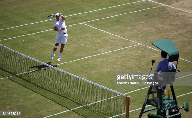 Marcus Willis in action during his doubles match with Jay Clarke on day seven of the Wimbledon Championships at The All England Lawn Tennis and...