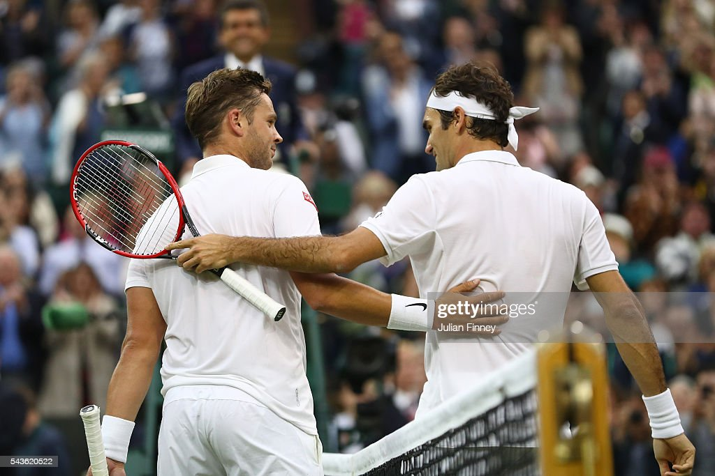 <a gi-track='captionPersonalityLinkClicked' href=/galleries/search?phrase=Marcus+Willis+-+Tennis+Player&family=editorial&specificpeople=16082201 ng-click='$event.stopPropagation()'>Marcus Willis</a> of Great Britain and <a gi-track='captionPersonalityLinkClicked' href=/galleries/search?phrase=Roger+Federer&family=editorial&specificpeople=157480 ng-click='$event.stopPropagation()'>Roger Federer</a> of Switzerland in conversation following the Men's Singles second round match on day three of the Wimbledon Lawn Tennis Championships at the All England Lawn Tennis and Croquet Club on June 29, 2016 in London, England.