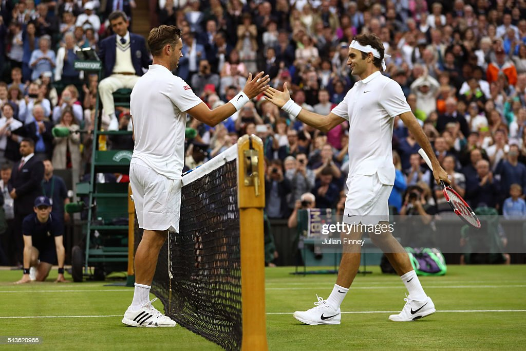 <a gi-track='captionPersonalityLinkClicked' href=/galleries/search?phrase=Marcus+Willis+-+Tennis+Player&family=editorial&specificpeople=16082201 ng-click='$event.stopPropagation()'>Marcus Willis</a> of Great Britain and <a gi-track='captionPersonalityLinkClicked' href=/galleries/search?phrase=Roger+Federer&family=editorial&specificpeople=157480 ng-click='$event.stopPropagation()'>Roger Federer</a> of Switzerland shake hands following the Men's Singles second round match on day three of the Wimbledon Lawn Tennis Championships at the All England Lawn Tennis and Croquet Club on June 29, 2016 in London, England.