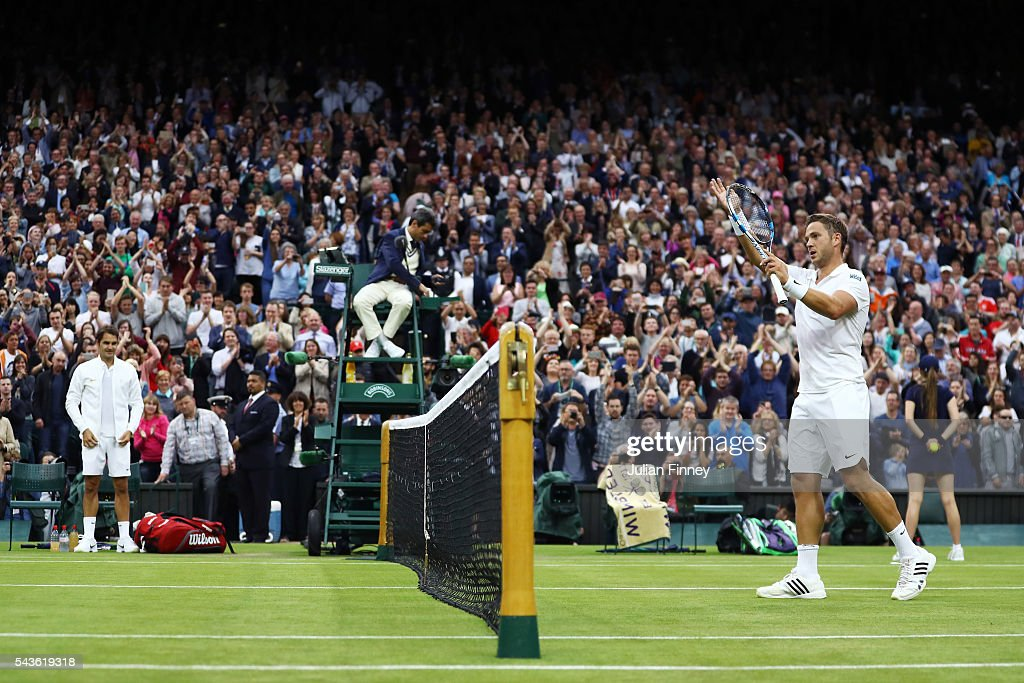 Marcus Willis of Great Britain applauds supporters following defeat during the Men's Singles second round match against Roger Federer of Switzerland on day three of the Wimbledon Lawn Tennis Championships at the All England Lawn Tennis and Croquet Club on June 29, 2016 in London, England.