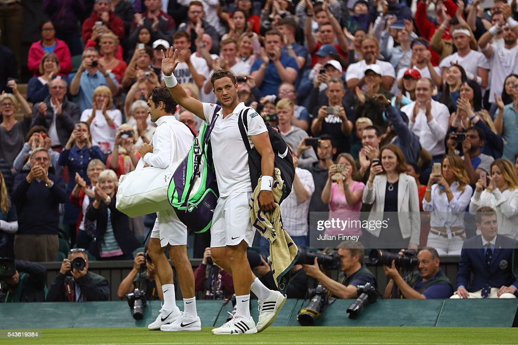<a gi-track='captionPersonalityLinkClicked' href=/galleries/search?phrase=Marcus+Willis+-+Tennis+Player&family=editorial&specificpeople=16082201 ng-click='$event.stopPropagation()'>Marcus Willis</a> of Great Britain applauds supporters following defeat during the Men's Singles second round match against Roger Federer of Switzerland on day three of the Wimbledon Lawn Tennis Championships at the All England Lawn Tennis and Croquet Club on June 29, 2016 in London, England.