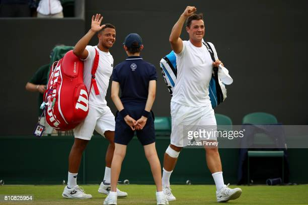 Marcus Willis of Great Britain celebrates with Jay Clarke of Great Britain after the Gentlemen's Doubles second round match against PierreHugues...