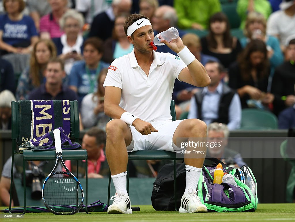 <a gi-track='captionPersonalityLinkClicked' href=/galleries/search?phrase=Marcus+Willis+-+Tennis+Player&family=editorial&specificpeople=16082201 ng-click='$event.stopPropagation()'>Marcus Willis</a> of Great Britain looks on during the Men's Singles second round match against Roger Federer of Switzerland on day three of the Wimbledon Lawn Tennis Championships at the All England Lawn Tennis and Croquet Club on June 29, 2016 in London, England.