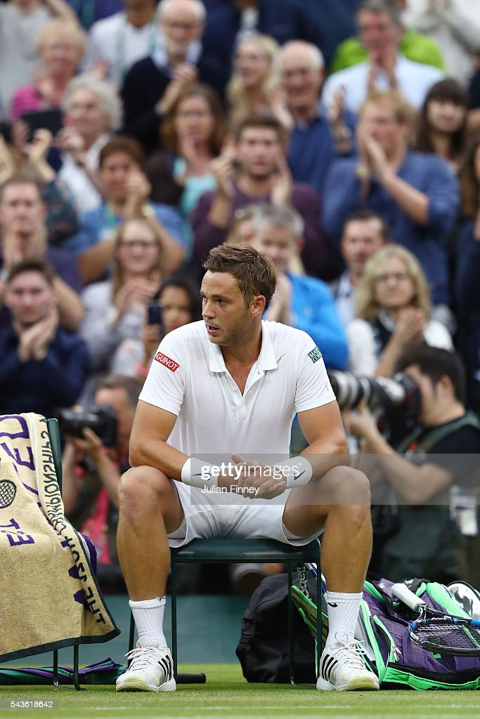 <a gi-track='captionPersonalityLinkClicked' href=/galleries/search?phrase=Marcus+Willis+-+Tennis+Player&family=editorial&specificpeople=16082201 ng-click='$event.stopPropagation()'>Marcus Willis</a> of Great Britain looks on following defeat during the Men's Singles second round match against Roger Federer of Switzerland on day three of the Wimbledon Lawn Tennis Championships at the All England Lawn Tennis and Croquet Club on June 29, 2016 in London, England.