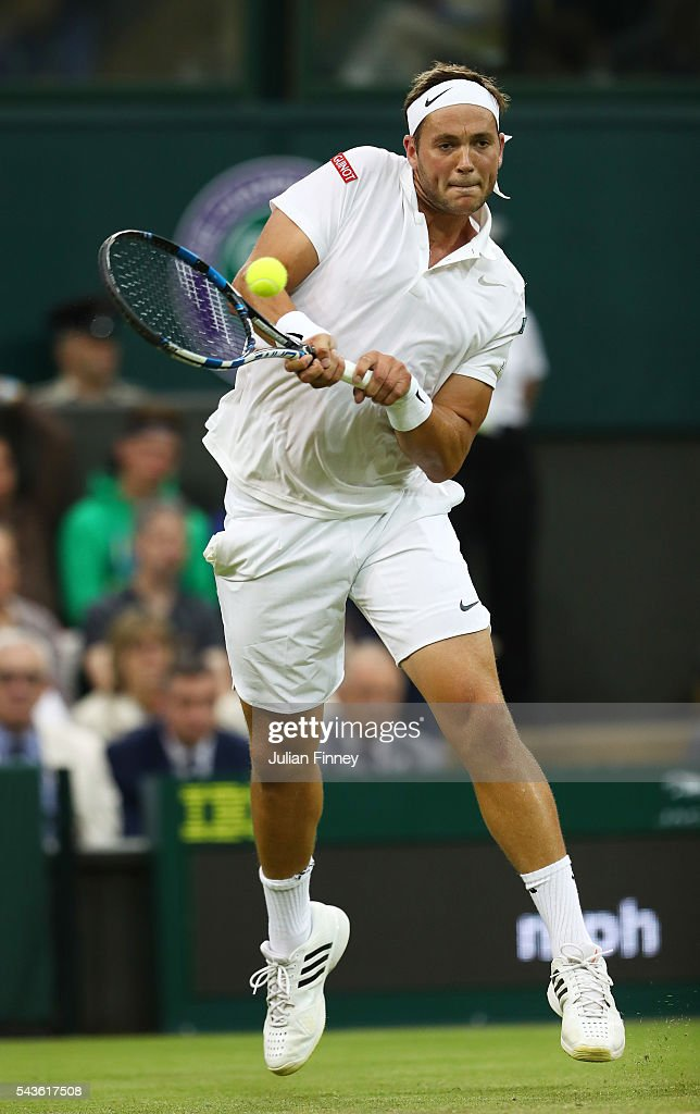 <a gi-track='captionPersonalityLinkClicked' href=/galleries/search?phrase=Marcus+Willis+-+Tennis+Player&family=editorial&specificpeople=16082201 ng-click='$event.stopPropagation()'>Marcus Willis</a> of Great Britain plays a backhand during the Men's Singles second round match against Roger Federer of Switzerland on day three of the Wimbledon Lawn Tennis Championships at the All England Lawn Tennis and Croquet Club on June 29, 2016 in London, England.