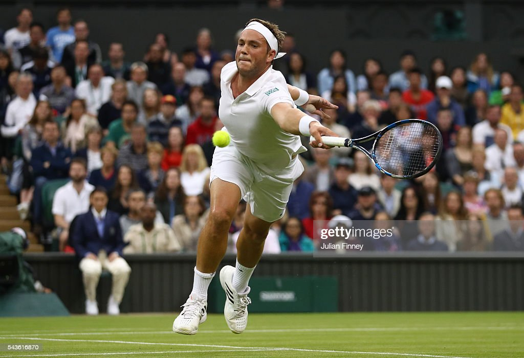 <a gi-track='captionPersonalityLinkClicked' href=/galleries/search?phrase=Marcus+Willis+-+Tennis+Player&family=editorial&specificpeople=16082201 ng-click='$event.stopPropagation()'>Marcus Willis</a> of Great Britain plays a forehand during the Men's Singles second round match against Roger Federer of Switzerland on day three of the Wimbledon Lawn Tennis Championships at the All England Lawn Tennis and Croquet Club on June 29, 2016 in London, England.