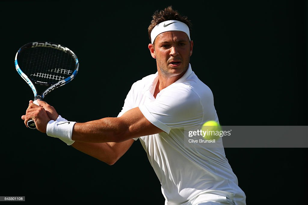 Marcus Willis of Great Britain plays a forehand shot during the Men's Singles first round match against Ricardas Berankis of Lithuania on day one of the Wimbledon Lawn Tennis Championships at the All England Lawn Tennis and Croquet Club on June 27th, 2016 in London, England.
