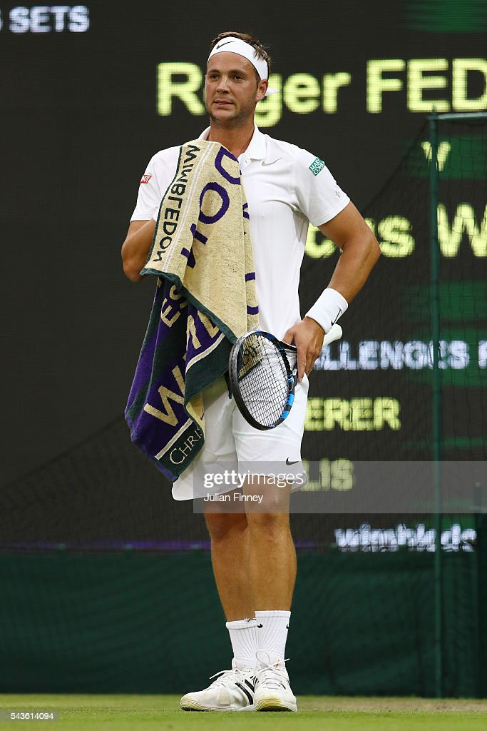 <a gi-track='captionPersonalityLinkClicked' href=/galleries/search?phrase=Marcus+Willis+-+Tennis+Player&family=editorial&specificpeople=16082201 ng-click='$event.stopPropagation()'>Marcus Willis</a> of Great Britain reacts during the Men's Singles second round match against Roger Federer of Switzerland on day three of the Wimbledon Lawn Tennis Championships at the All England Lawn Tennis and Croquet Club on June 29, 2016 in London, England.