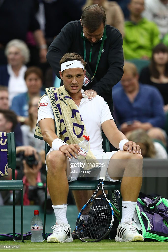 <a gi-track='captionPersonalityLinkClicked' href=/galleries/search?phrase=Marcus+Willis+-+Tennis+Player&family=editorial&specificpeople=16082201 ng-click='$event.stopPropagation()'>Marcus Willis</a> of Great Britain recieves treatment from his physio during the Men's Singles second round match against Roger Federer of Switzerland on day three of the Wimbledon Lawn Tennis Championships at the All England Lawn Tennis and Croquet Club on June 29, 2016 in London, England.