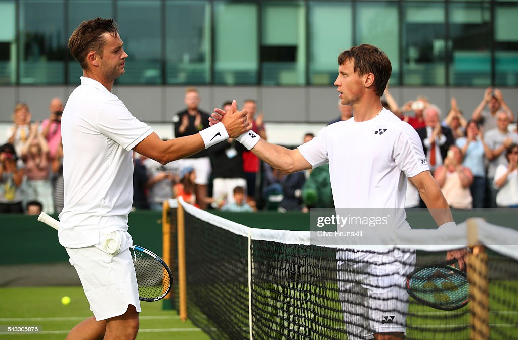 Marcus Willis of Great Britain shakes hands with Ricardas Berankis of Lithuania during the Men's Singles first round match on day one of the Wimbledon Lawn Tennis Championships at the All England Lawn Tennis and Croquet Club on June 27th, 2016 in London, England.