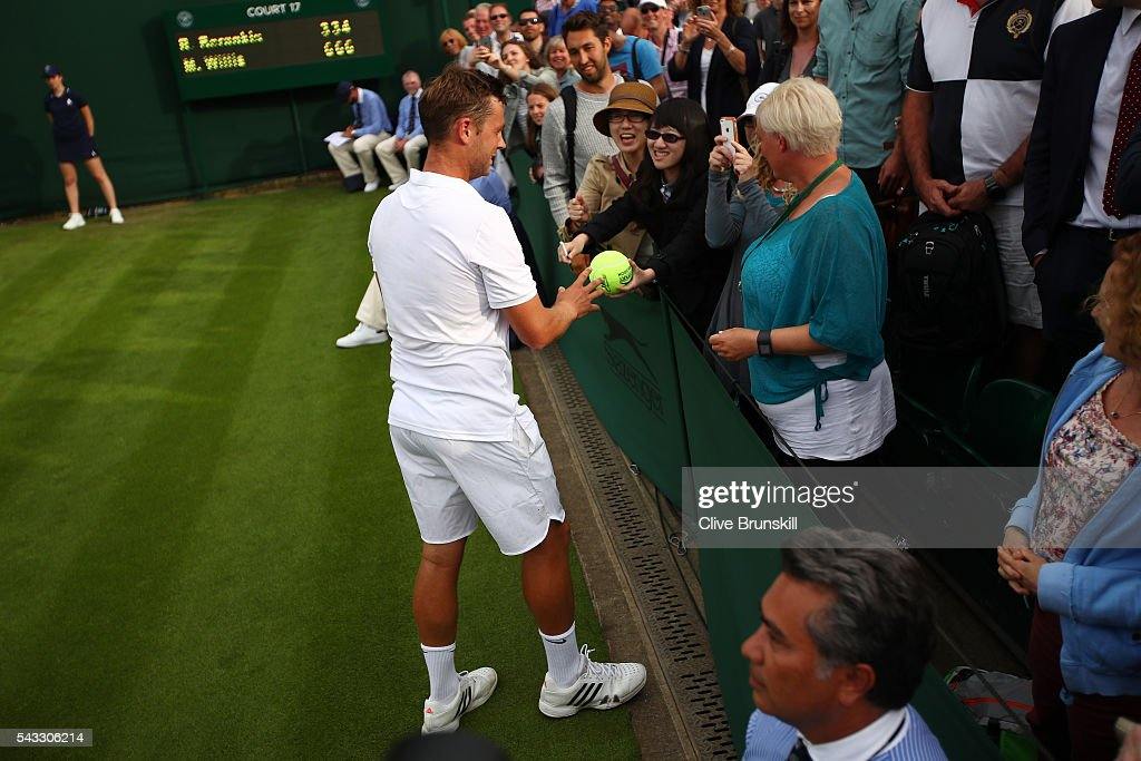 Marcus Willis of Great Britain signs autographs following victory during the Men's Singles first round match against Ricardas Berankis of Lithuania on day one of the Wimbledon Lawn Tennis Championships at the All England Lawn Tennis and Croquet Club on June 27th, 2016 in London, England.
