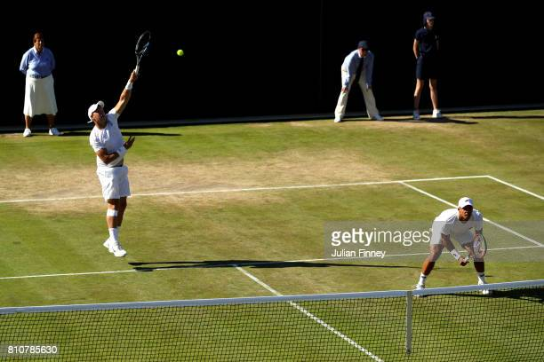 Marcus Willis of Great Britain volleys during the Gentlemen's Doubles second round match with Jay Clarke of Great Britain against PierreHugues...