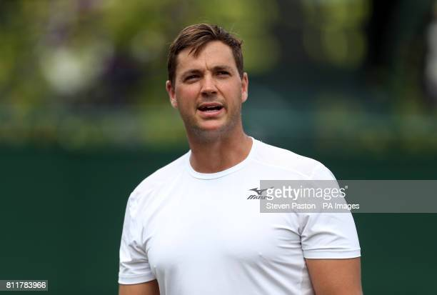 Marcus Willis speaks to the umpire during his doubles match with Jay Clarke on day seven of the Wimbledon Championships at The All England Lawn...
