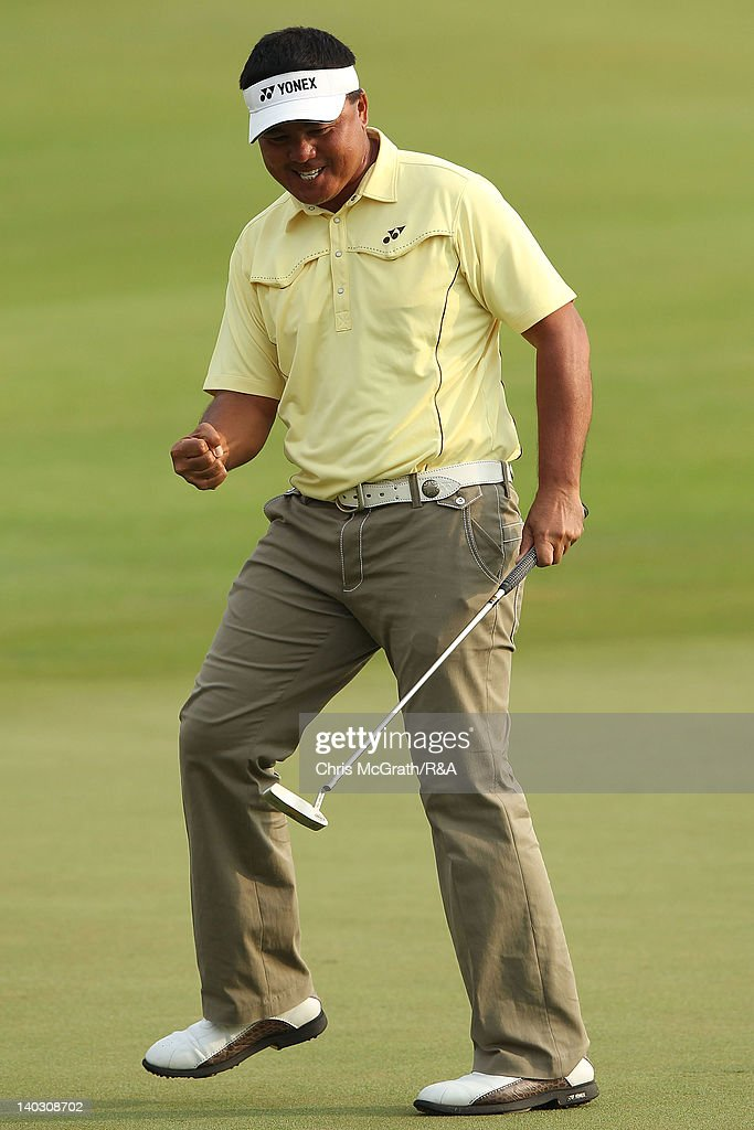 <a gi-track='captionPersonalityLinkClicked' href=/galleries/search?phrase=Mardan+Mamat&family=editorial&specificpeople=220766 ng-click='$event.stopPropagation()'>Mardan Mamat</a> of Singapore celebrates his putt to win a three way playoff on the 18th green during round two of The Open Championship International Final Qualifying Asia at Amata Springs Country Club on March 2, 2012 in Bangkok, Thailand.