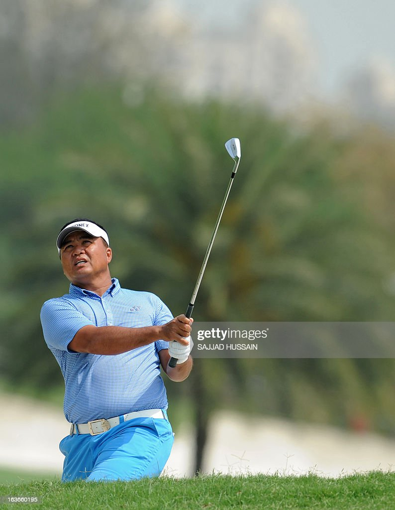 Mardan Mamat of Singapore looks on after playing a shot from the bunker during the Avantha Masters golf tournament in Greater Noida, on the outskirts of New Delhi, on March 14, 2013. AFP PHOTO/ Sajjad Hussain