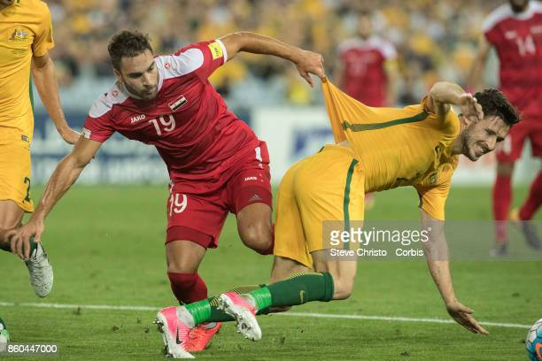 Mardek Mardkian of Syria and Mathew Leckie of Australia compete during the 2018 FIFA World Cup Asian Playoff match between the Australian Socceroos...