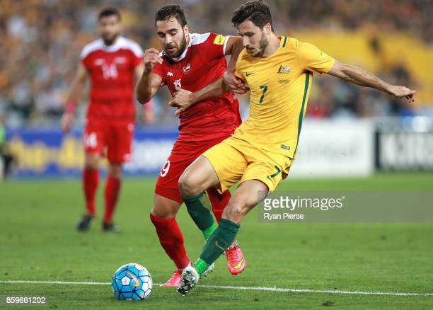 Mardek Mardkian of Syria competes for the ball against Matthew Leckie of Australia during the 2018 FIFA World Cup Asian Playoff match between the...