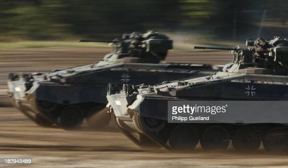 Marder armoured troop carriers are seen during the annual military exercises held for the media at the Bergen military training grounds on October 2...