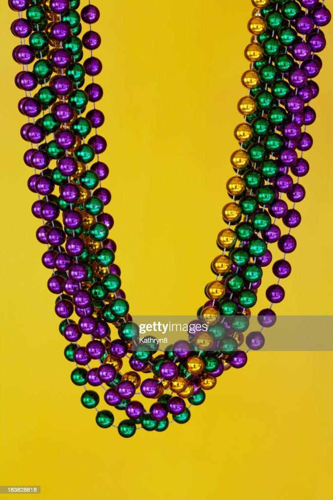 Mardi Gras Beads on Yellow