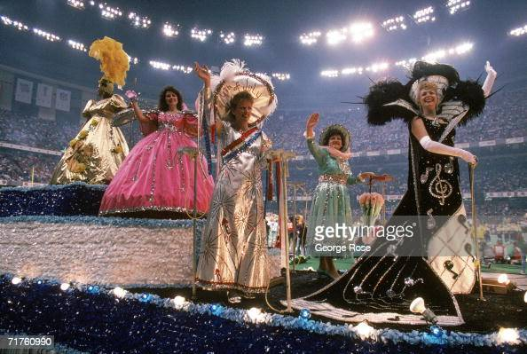 Mardi Gras style floats with women waving roll by during the pregame show before the San Francisco 49ers take on the Denver Broncos prior to Super...