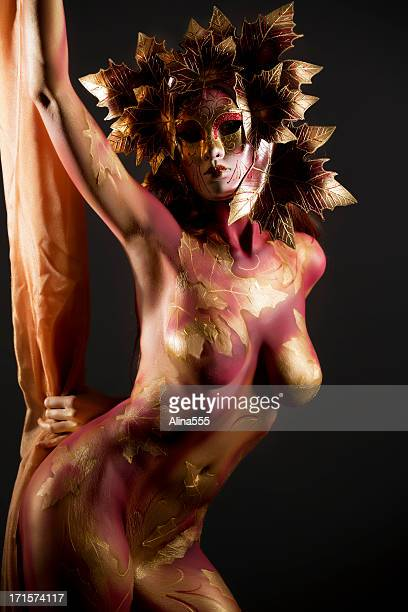 Mardi Gras: woman with bodypainting wearing a mask