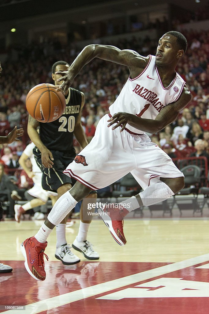 Mardracus Wade #1 of the Arkansas Razorbacks saves the ball from going out of bounds against the Vanderbilt Commodores at Bud Walton Arena on January12, 2013 in Fayetteville, Arkansas. The Razorbacks defeated the Commodores 56-33.