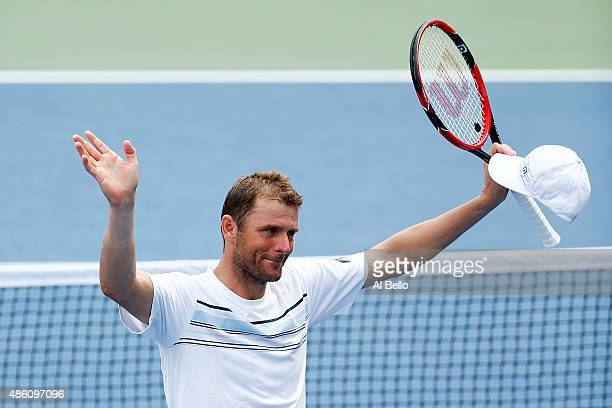 Mardy Fish of the United States reacts after defeating Marco Cecchinato of Italy during his Men's Singles First Round match on Day One of the 2015 US...